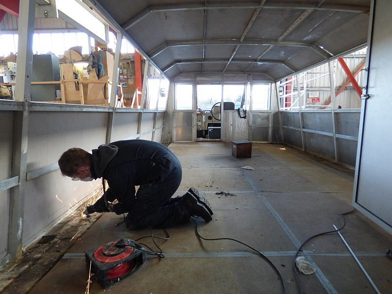 internal progress shot of works onboard queen of the broads with man using power tools
