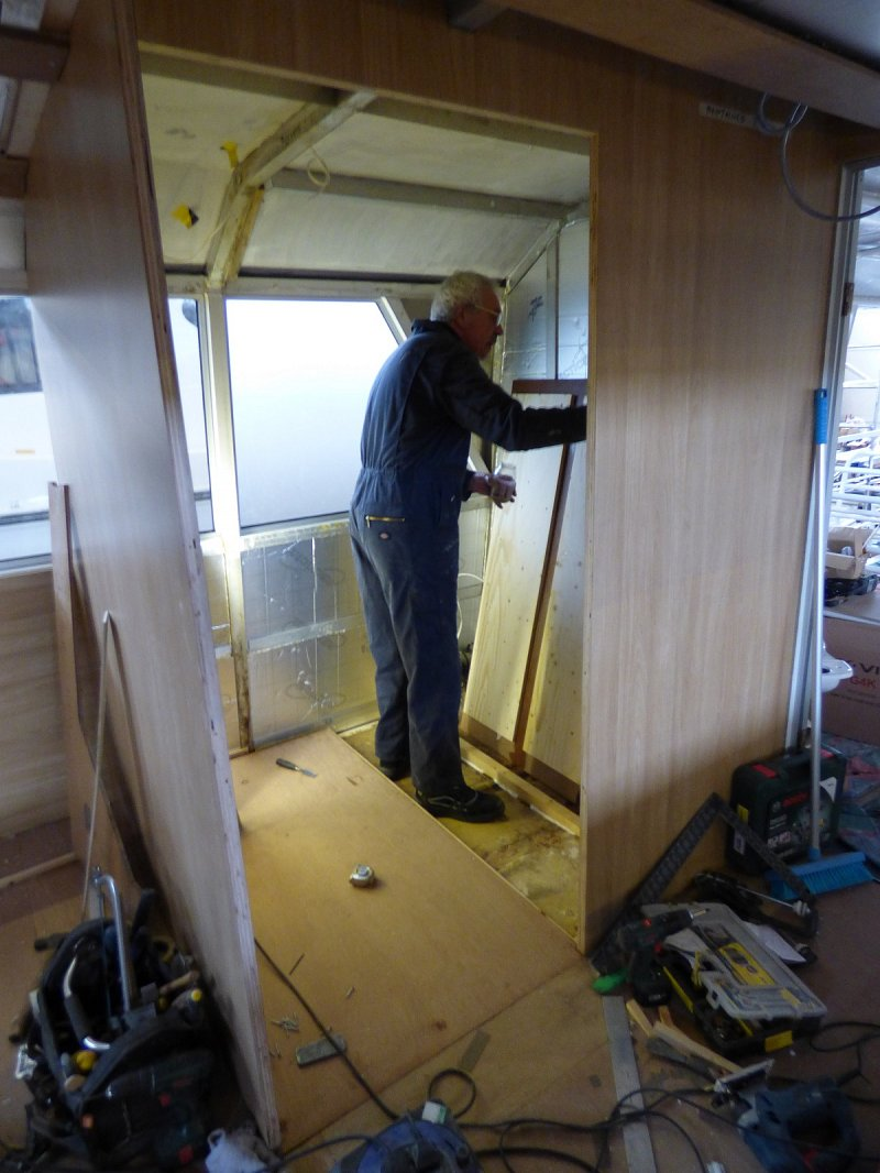 man working on internal toilet area of queen of the broads