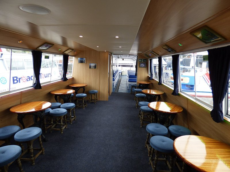 queen of the broads internal shot of tables and stools
